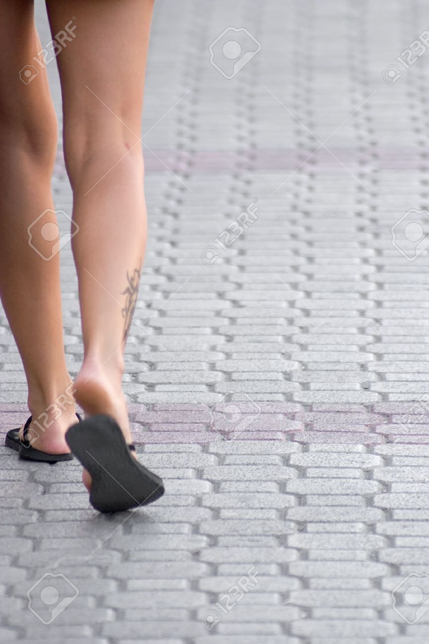 Sexy Female Legs Walking Down The Street Stock Photo 4359994