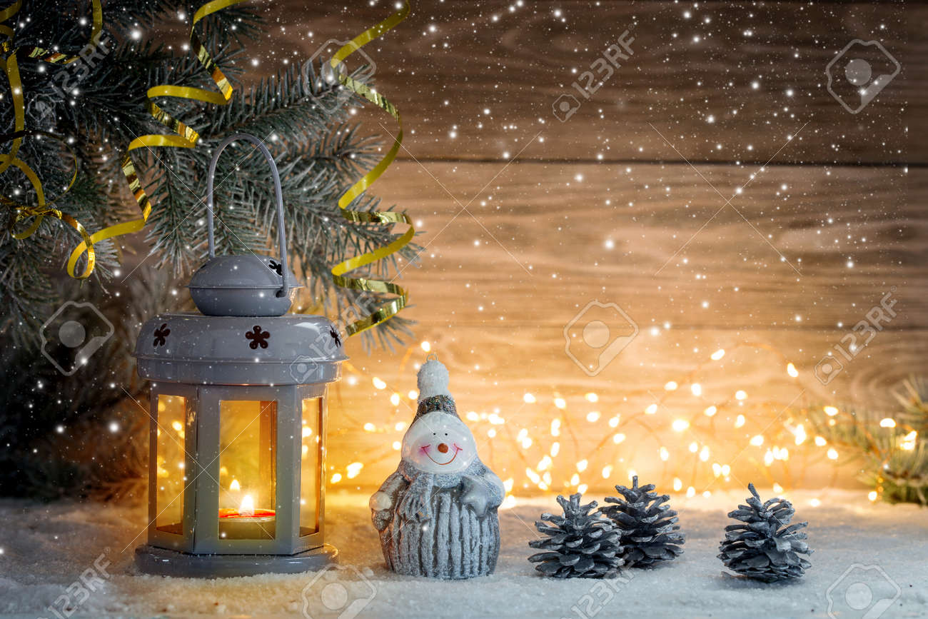 Lantern candlestick and Christmas decorations on a wooden background. Copy space. - 134597840