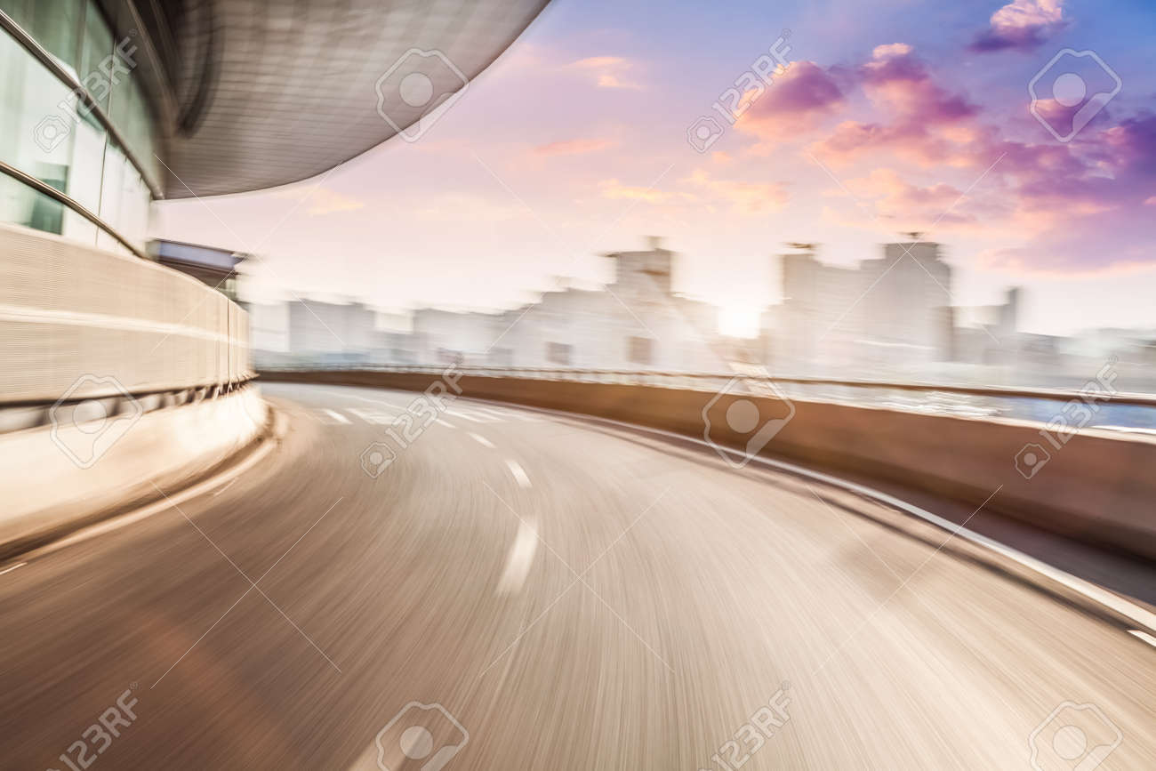 Car driving on road in city background, motion blur - 52407149