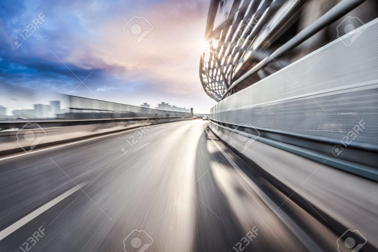 Car driving on road in city background, motion blur - 52408452