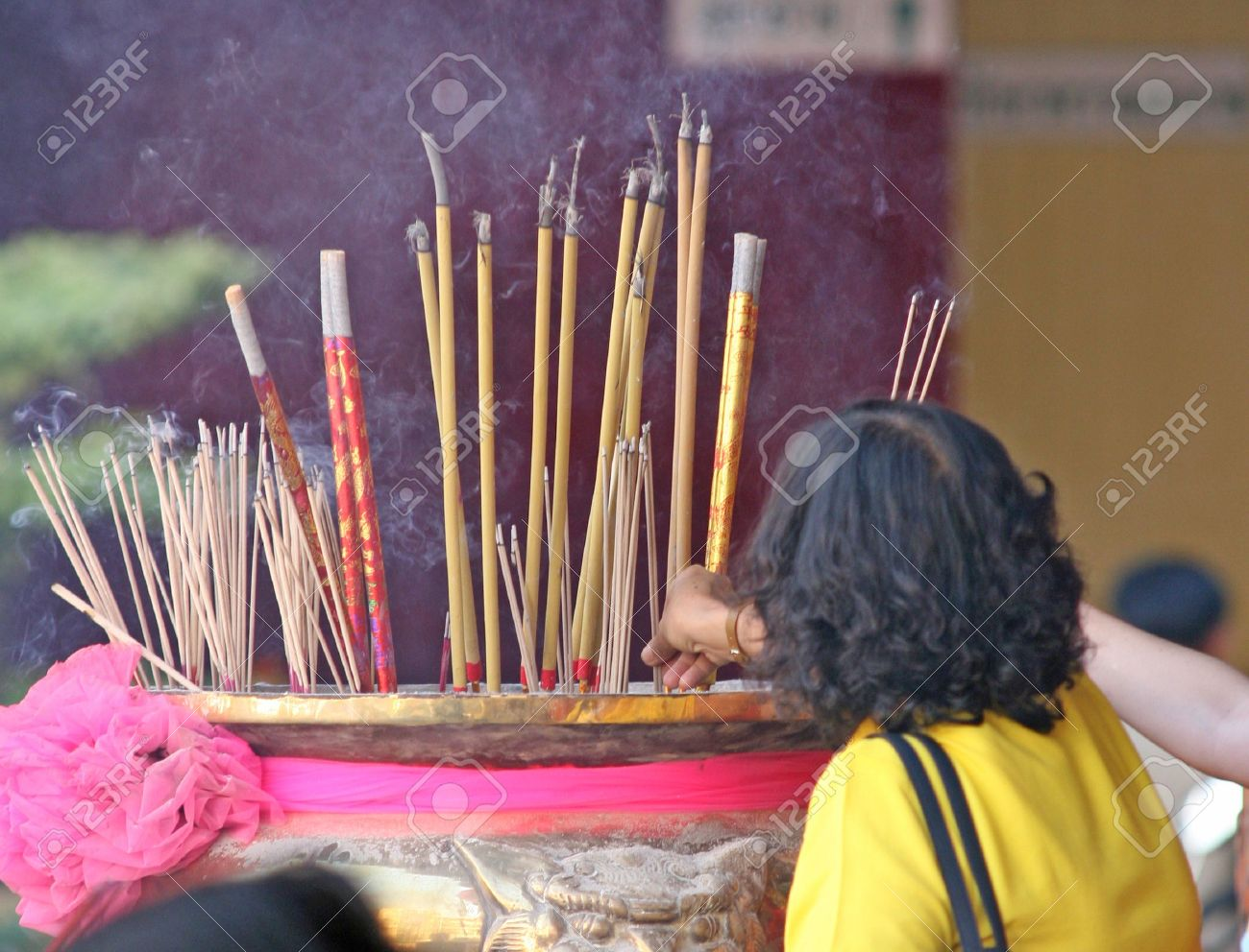 Burning incense in a temple to bring good luck during Chinese New Year Stock Photo - 782954