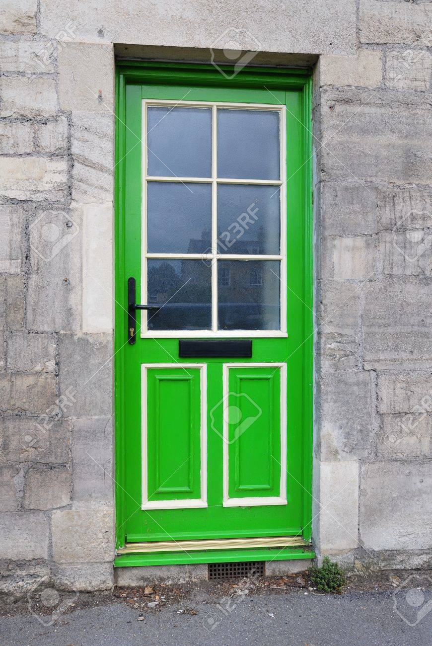 Green Front Door Of An Old Stone Cottage Stock Photo   8297284