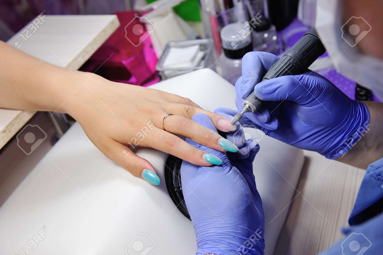 Repair Old Gel Nails With A Nail Grinder In The Nail Salon. The ...