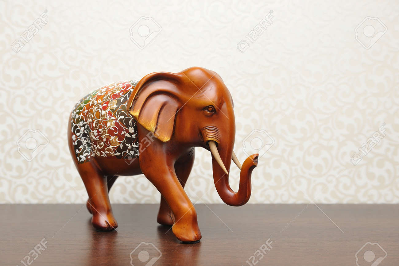 wooden figure of an elephant in a home interior brown color stock