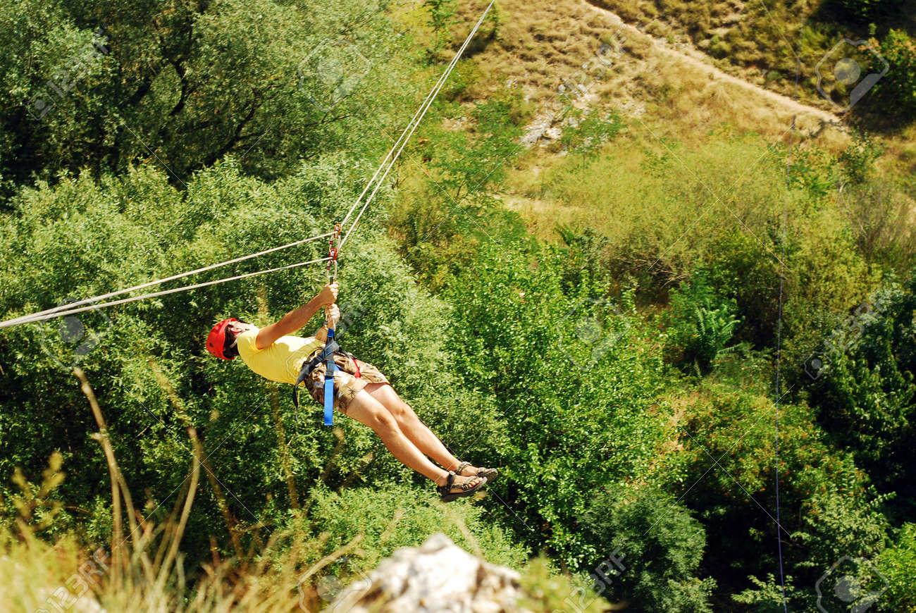 man descending on a zip-line (flying fox) Stock Photo - 14650206