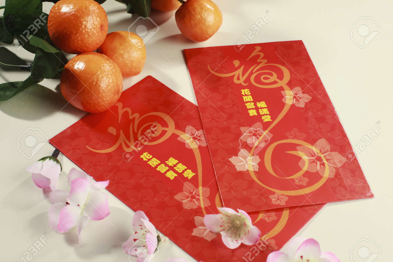 Red packets with mandarin oranges and plum blossoms Stock Photo - 4186925