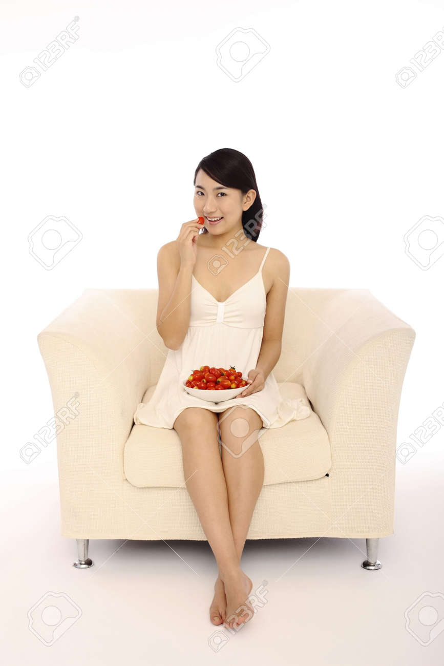 Woman holding a bowl of cherry tomatoes Stock Photo - 4194543