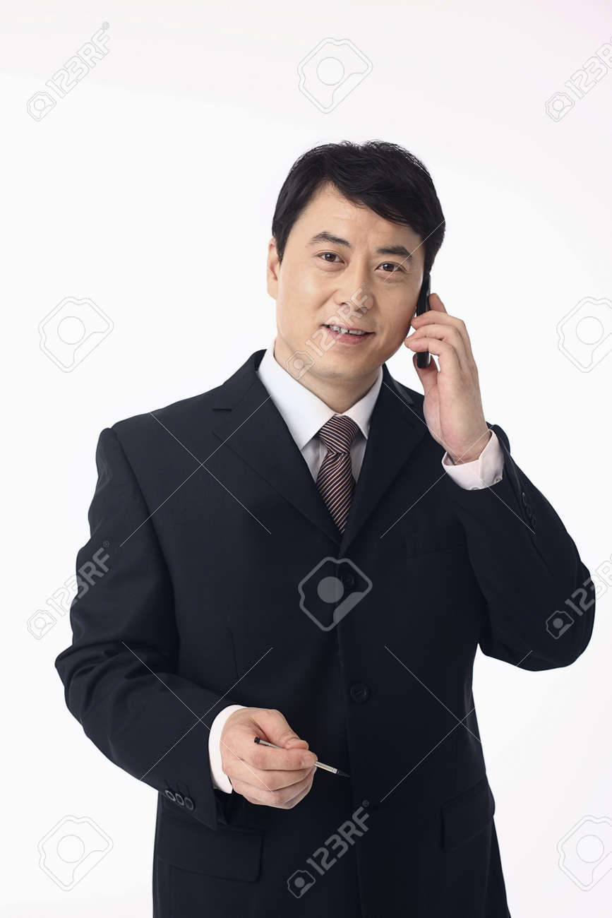 Businessman talking on the phone, hand holding stylus Stock Photo - 4194521