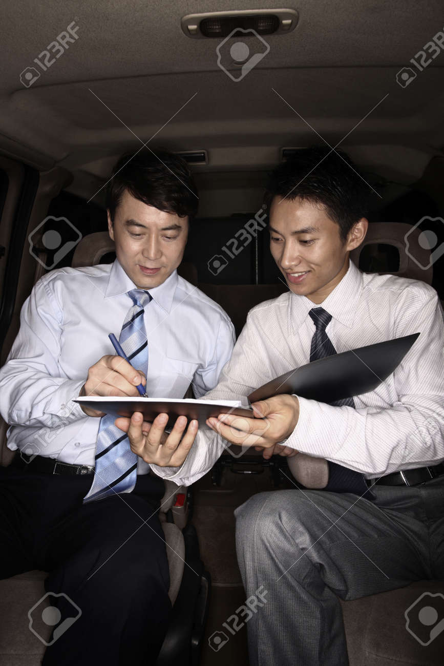 Businessman signing contract in the car Stock Photo - 4194783