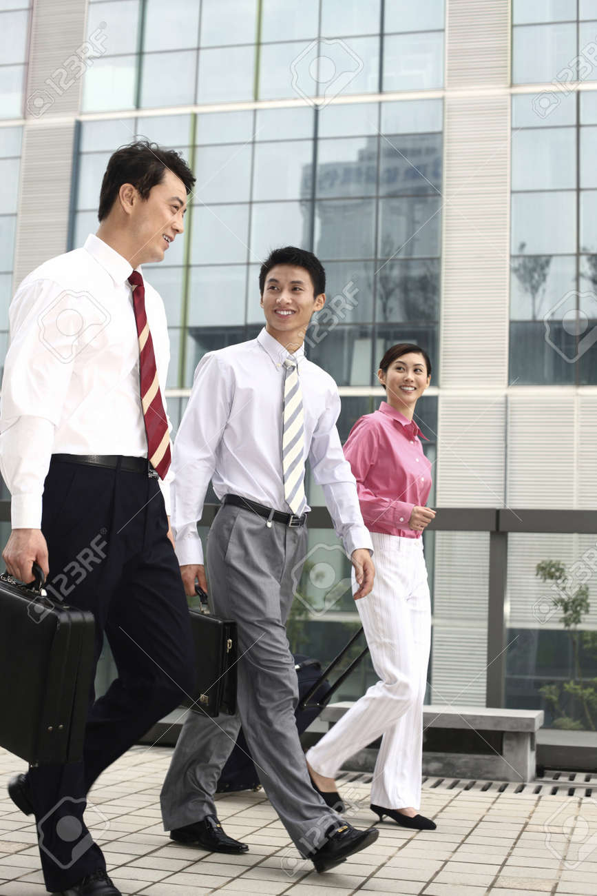 Business people chatting while walking Stock Photo - 4194717