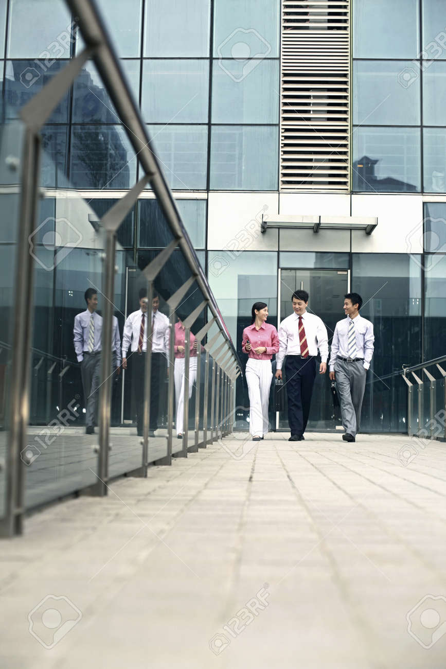 Business people chatting while walking back Stock Photo - 4194776