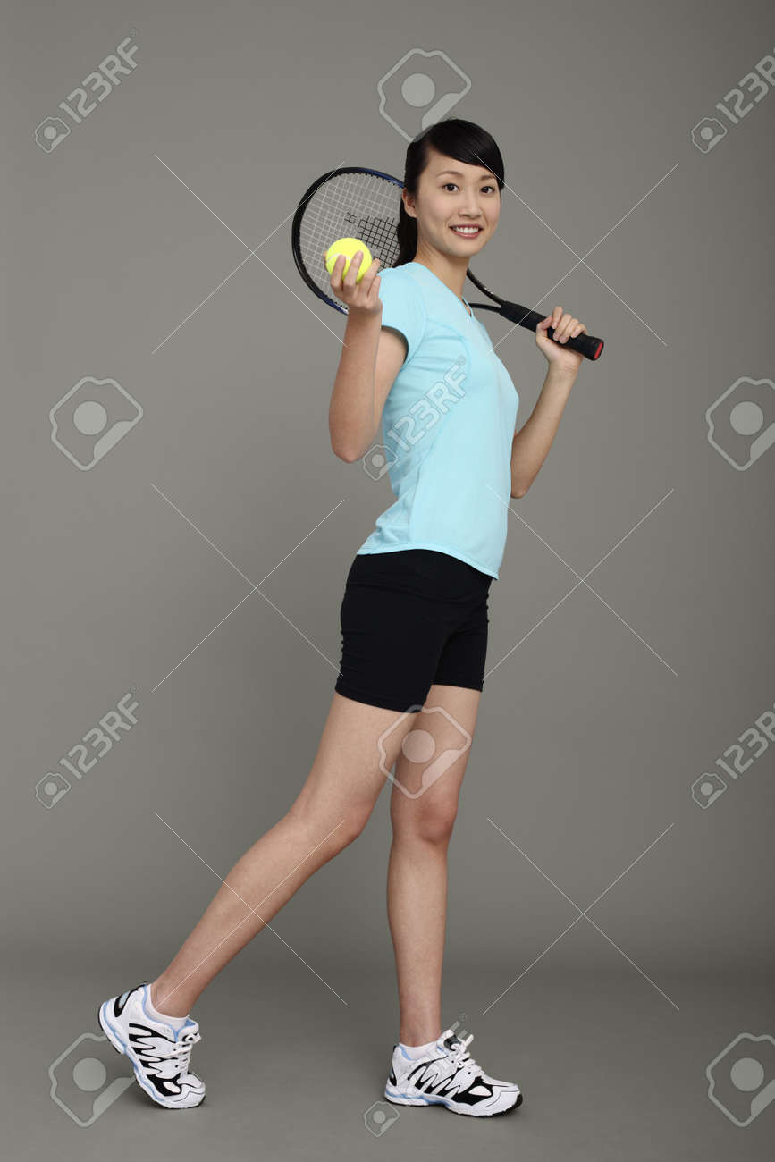 Woman holding tennis racket and tennis ball Stock Photo - 4194598