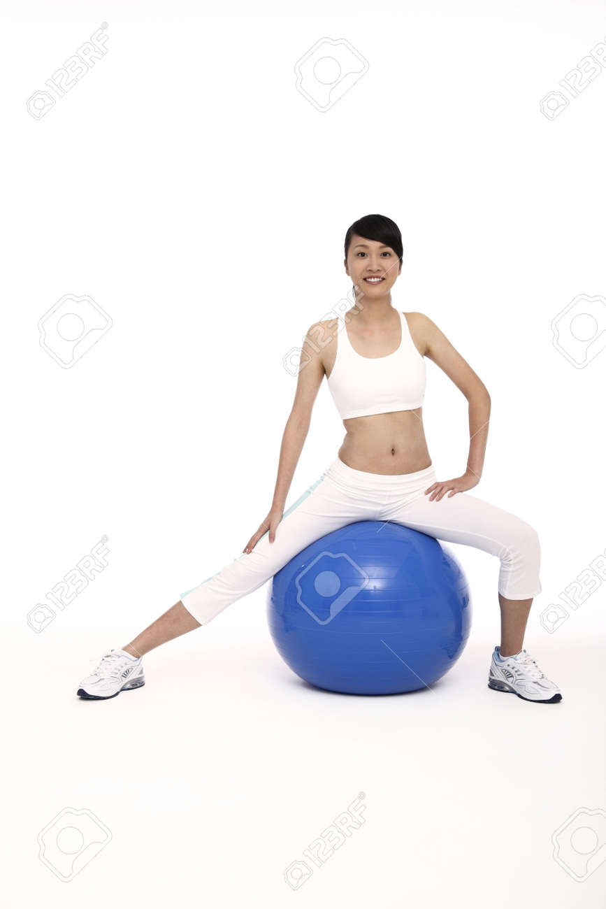 Woman exercising on fitness ball Stock Photo - 4194421