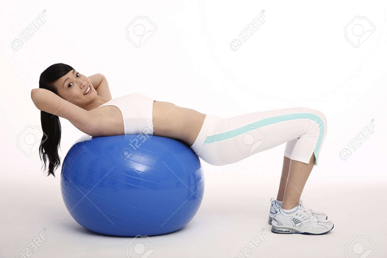Woman exercising on fitness ball Stock Photo - 4194525
