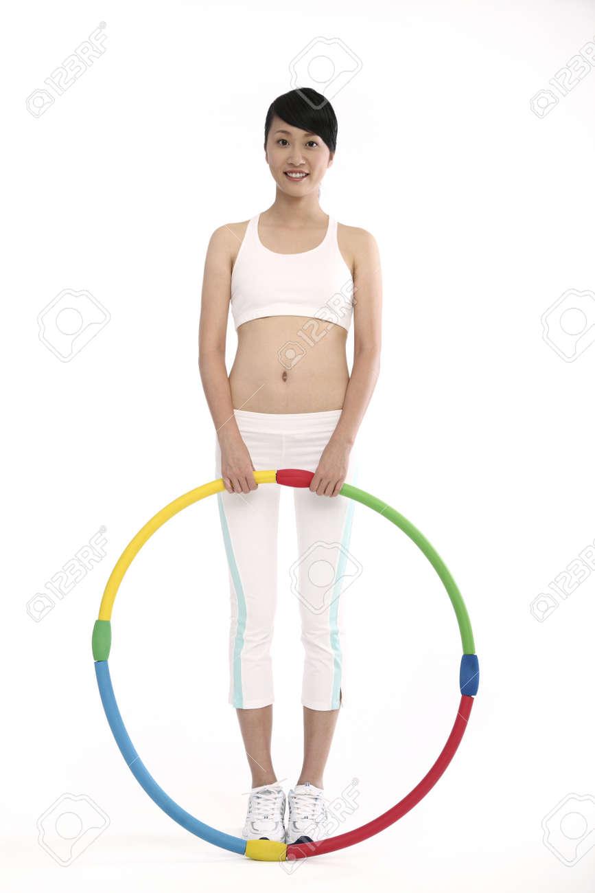 Woman holding hula hoop Stock Photo - 4194420