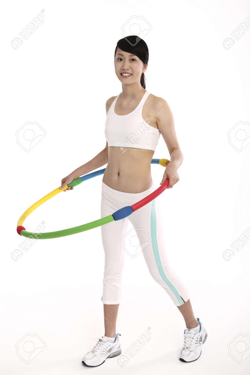Woman exercising with hula hoop Stock Photo - 4194348