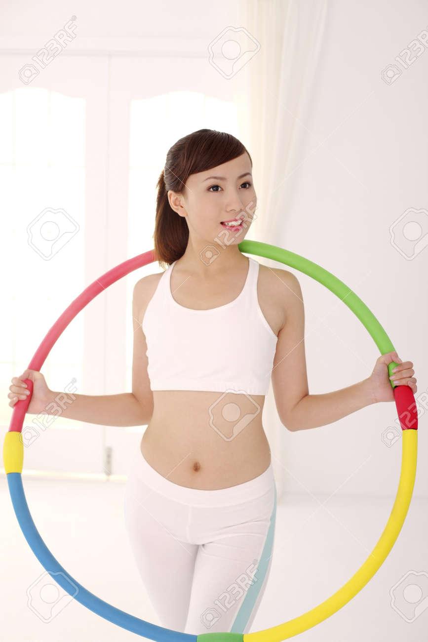 Woman with hula hoop Stock Photo - 4194532