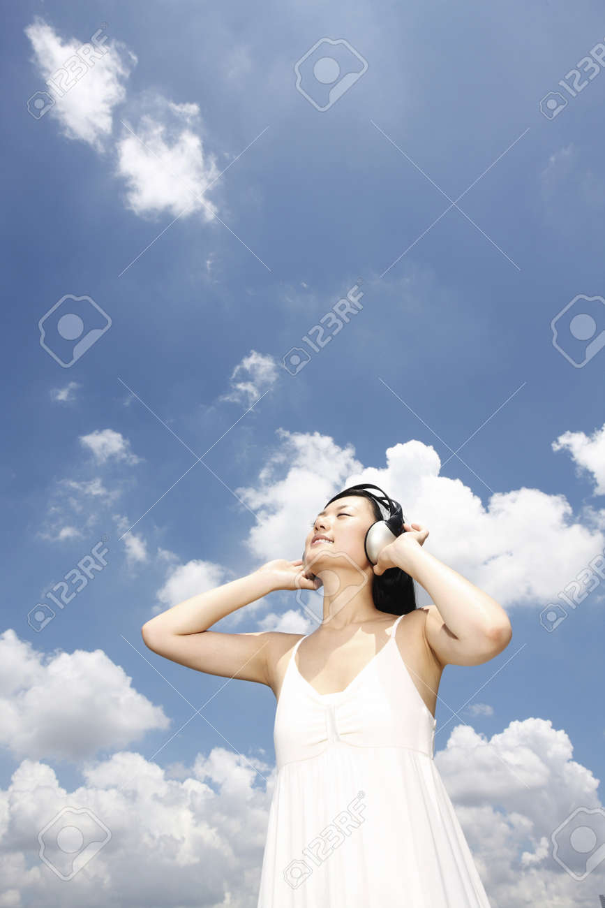 Woman listening to headphones Stock Photo - 4197467