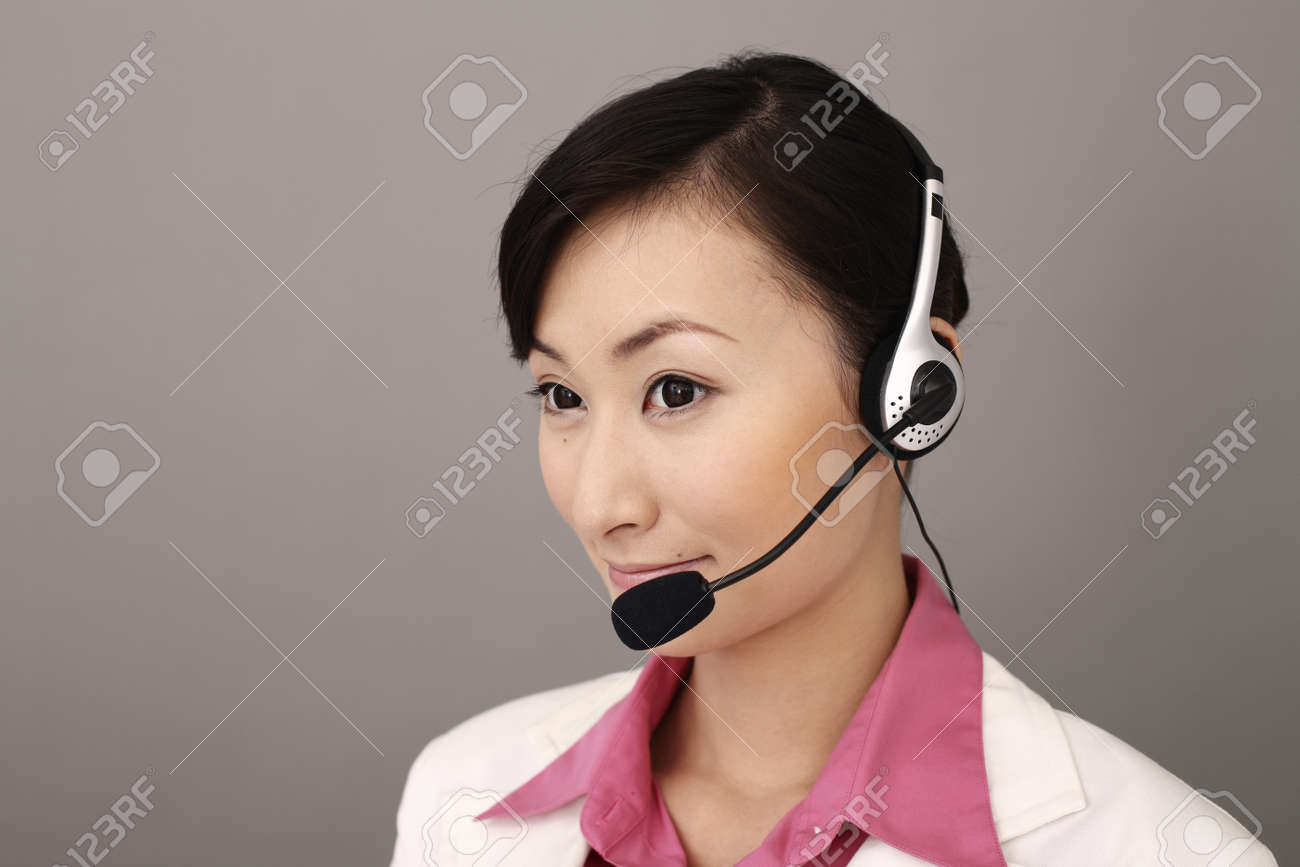 Businesswoman with telephone headset Stock Photo - 4197578