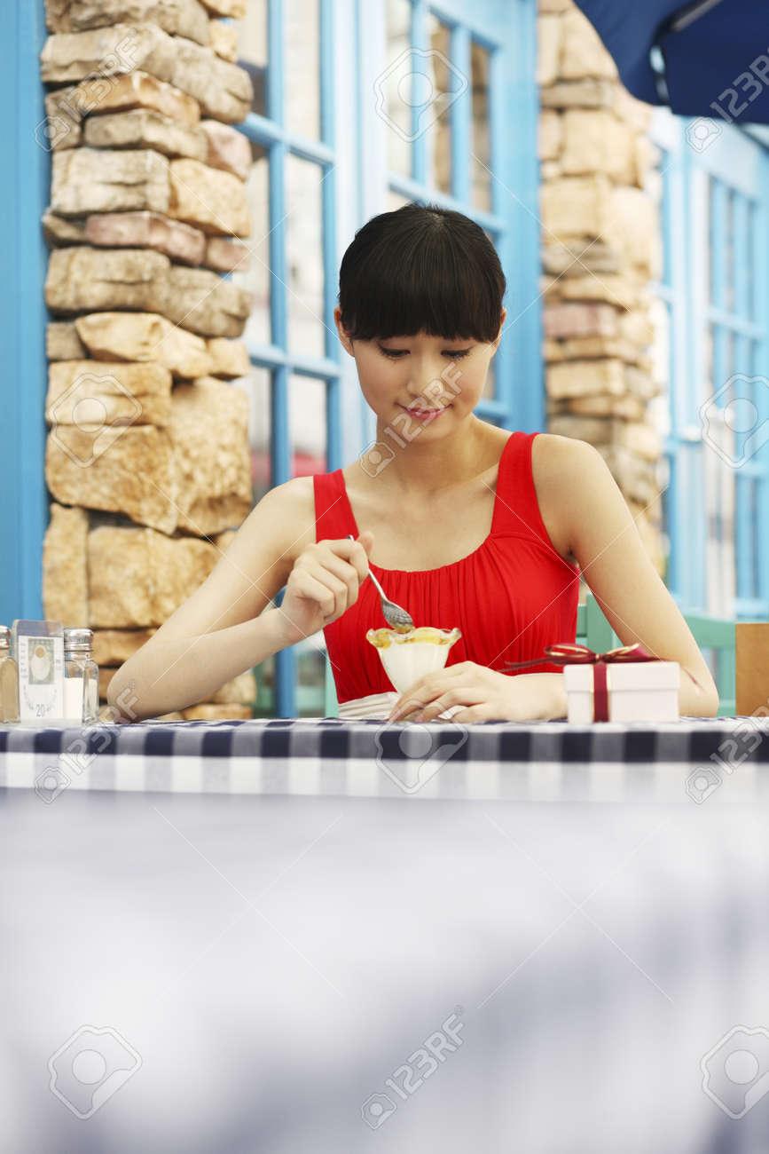 Woman enjoying ice-cream Stock Photo - 4197661