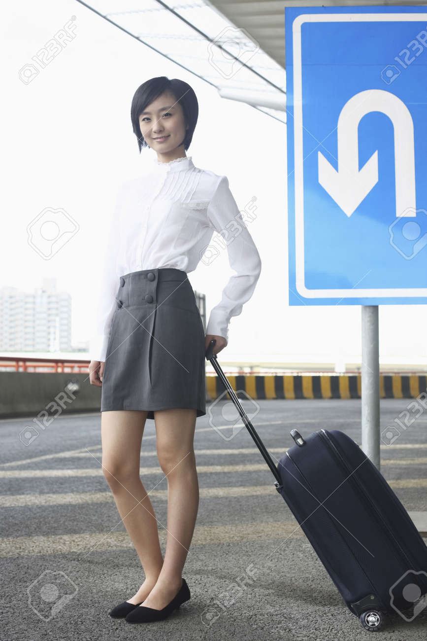 Woman with suitcase waiting at the train station Stock Photo - 4630951