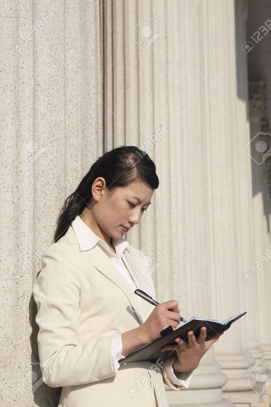 Businesswoman writing in organizer Stock Photo - 4635980