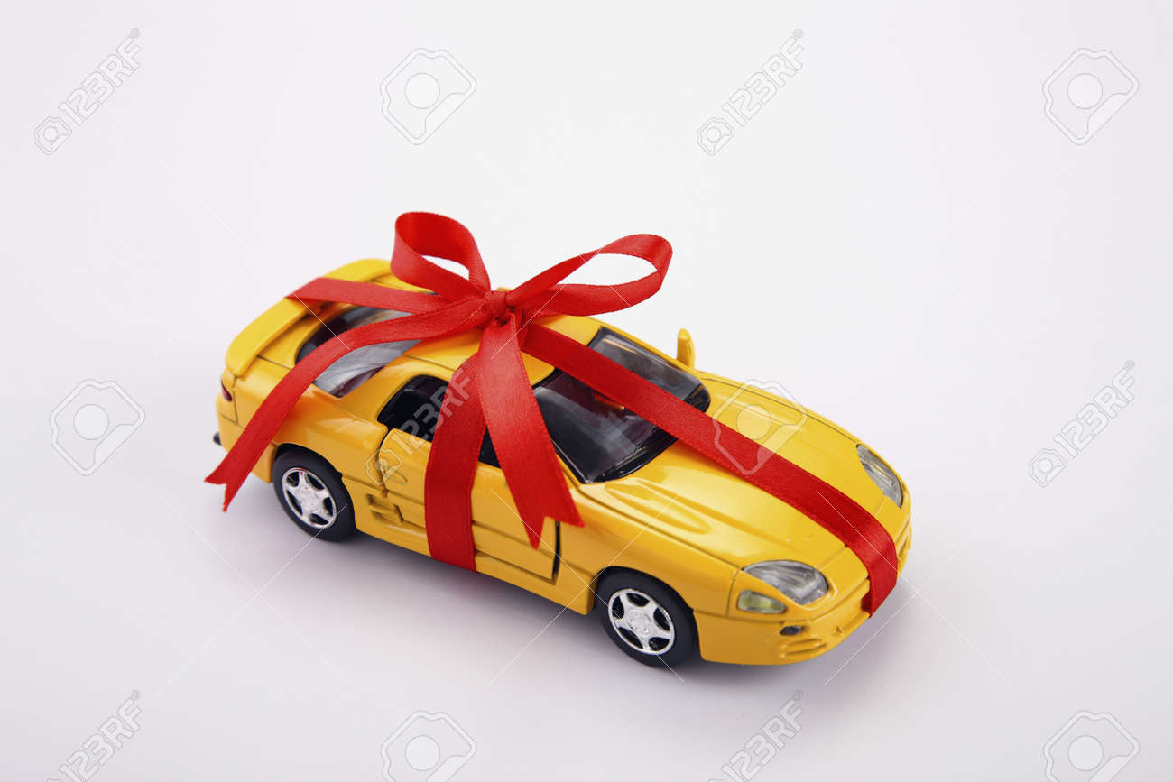 Yellow Toy Car Gift Wrapped With Red Ribbon Stock Photo Picture And