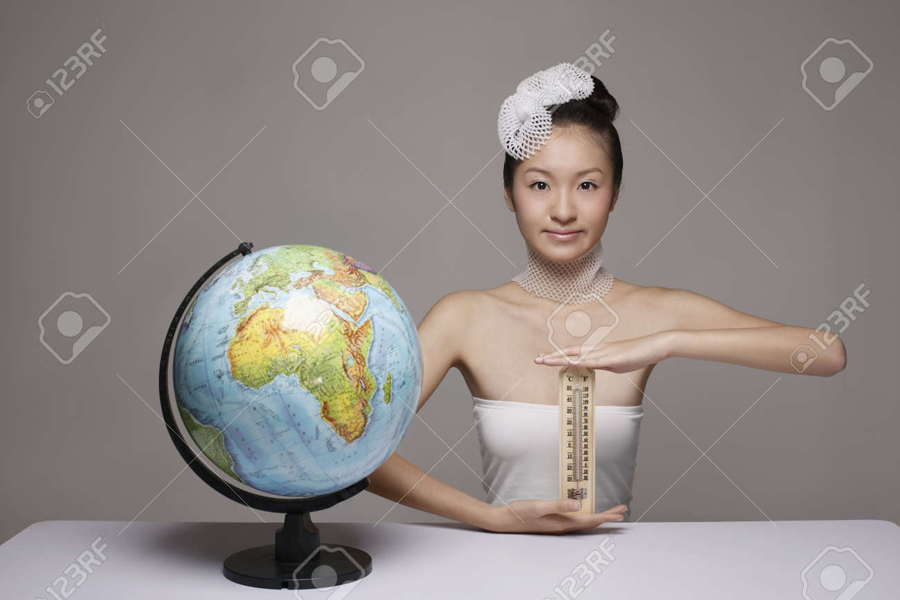 Woman wearing foam net accessories holding thermometer Stock Photo - 4653865