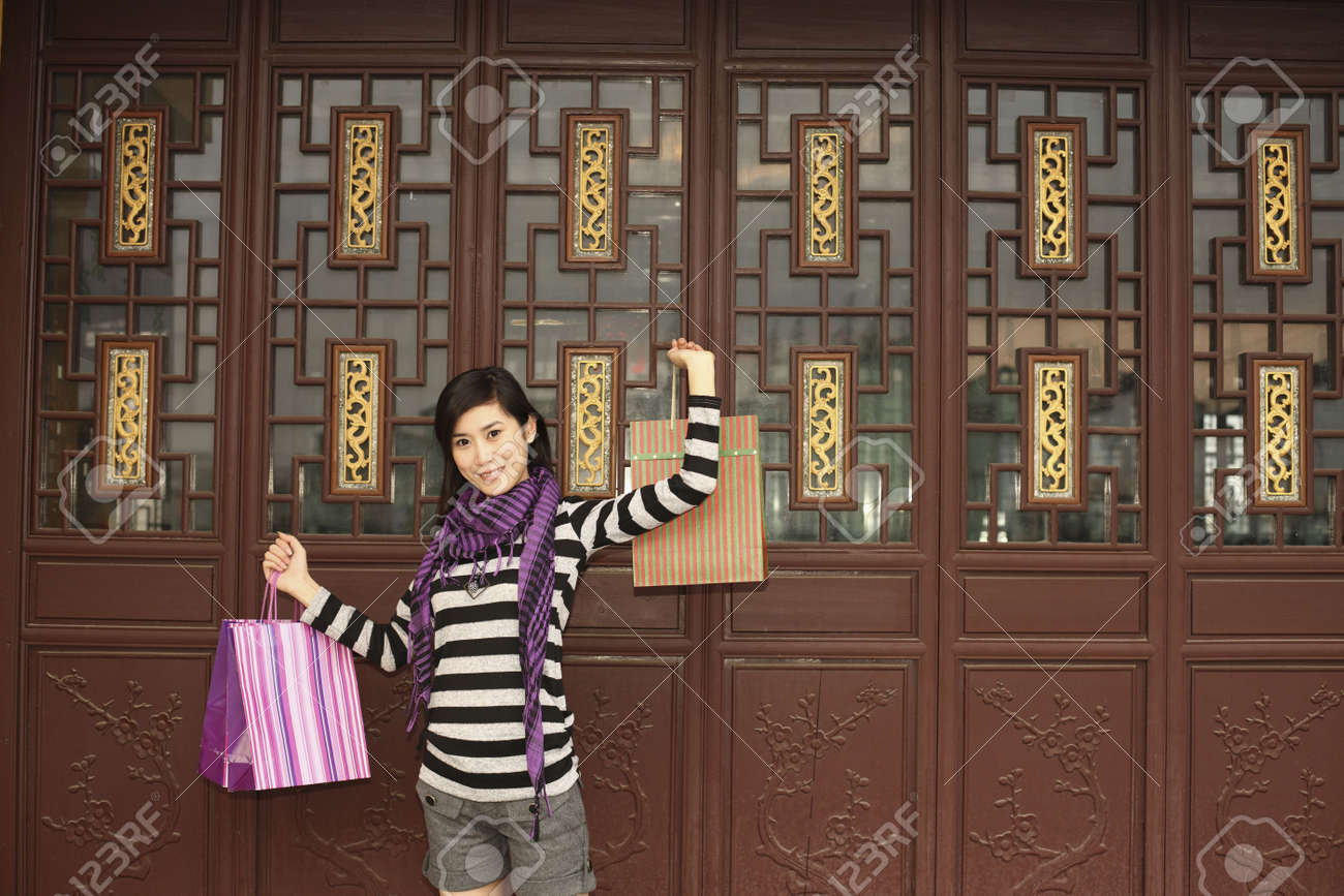Woman holding up paper bags Stock Photo - 10296522