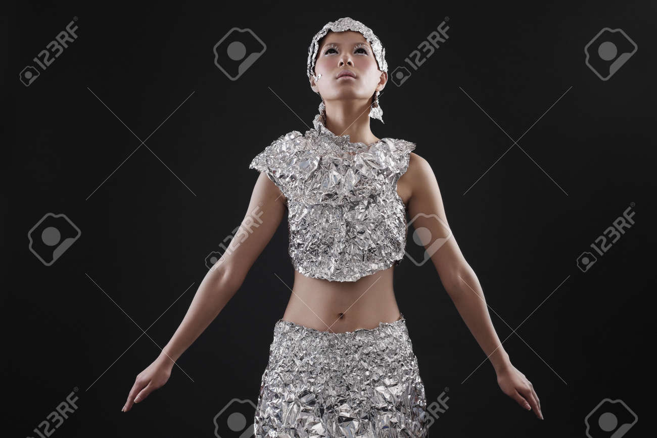 Woman wearing foil accessories looking upwards Stock Photo - 10296508