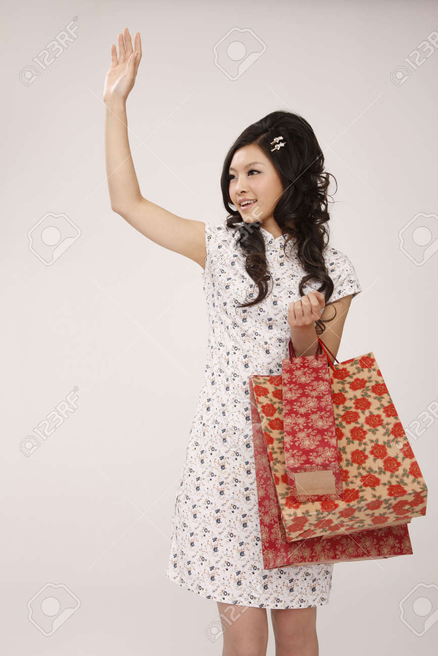 Woman with paperbags raising her hand Stock Photo - 10294723
