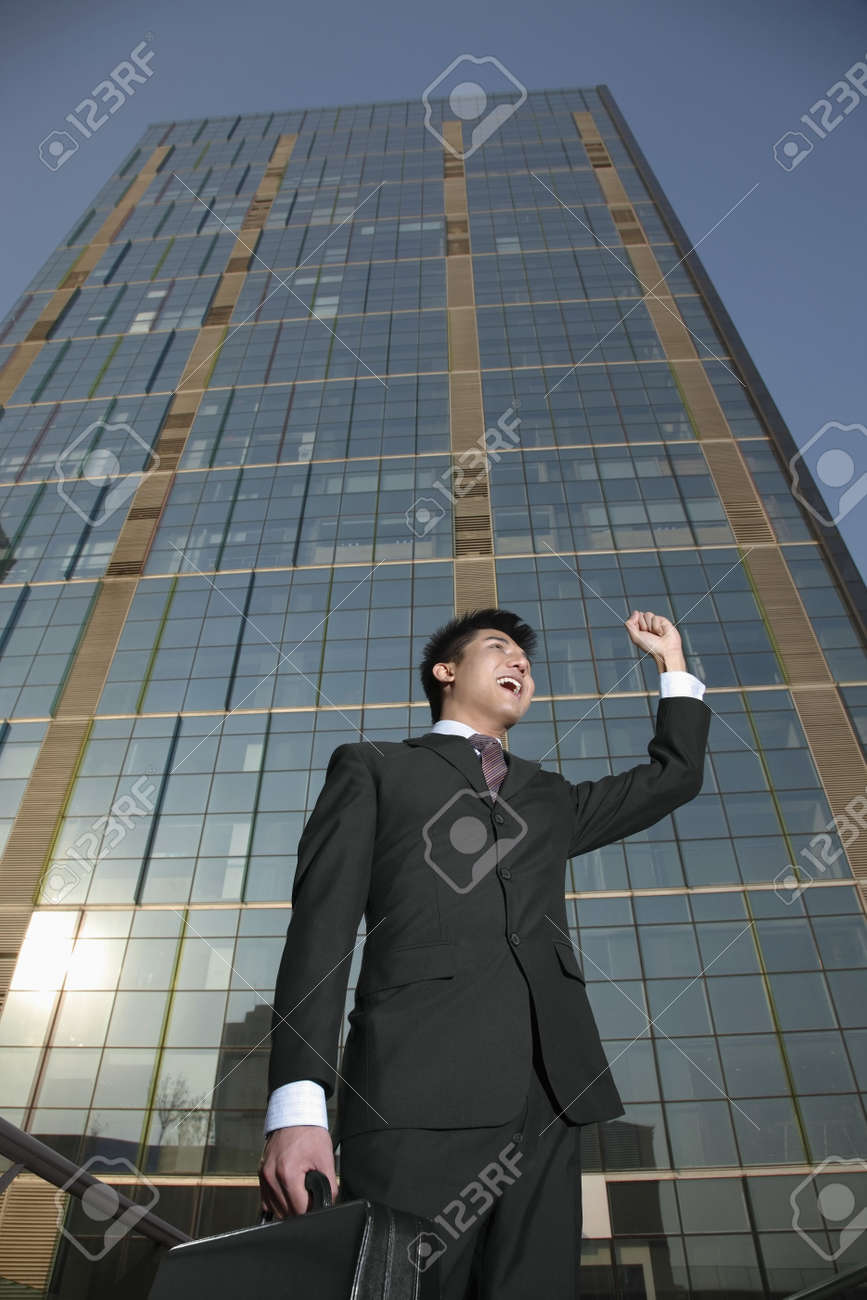 Businessman shouting while punching fist in the air Stock Photo - 4810616