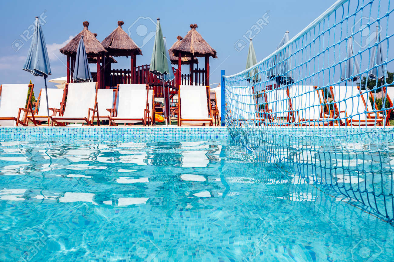 Water volleyball net in swimming pool, summertime