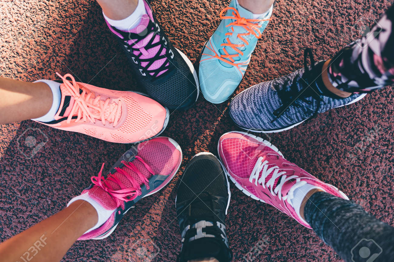 a445e5b9e944 Closeup legs of athletes wearing sports shoes in a circle Stock Photo -  62714072