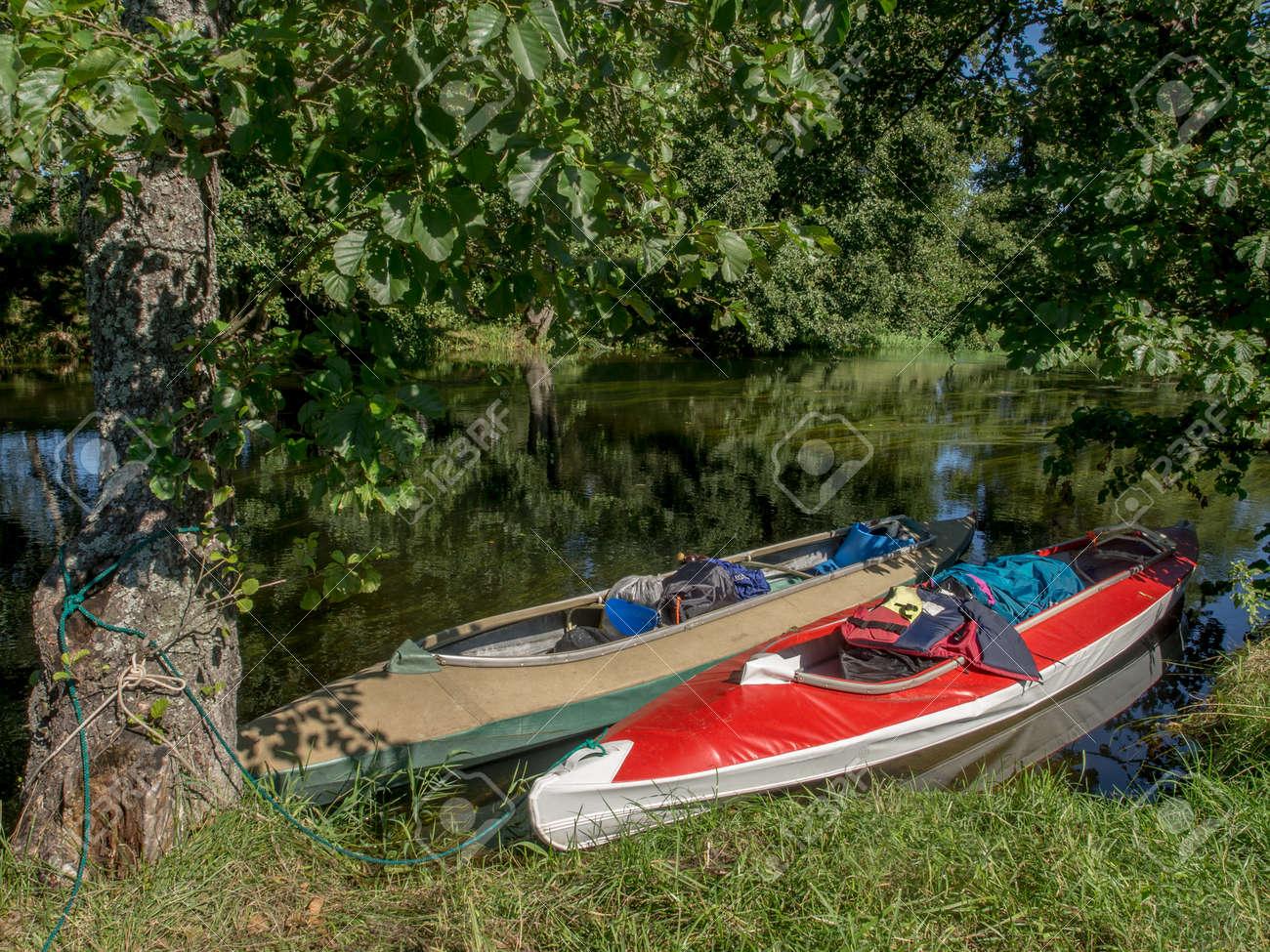 Folding kayaks at a bank of a the river Wda