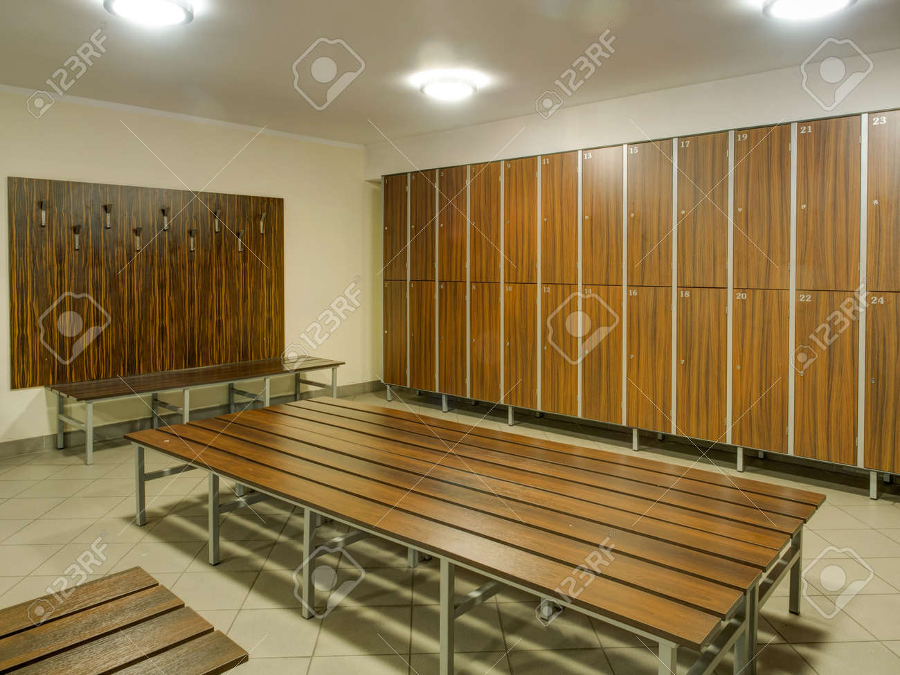 Stock Photo   The Row Of Wooden Cabinets And A Wooden Bench In A Fitness  Club Dressing Room