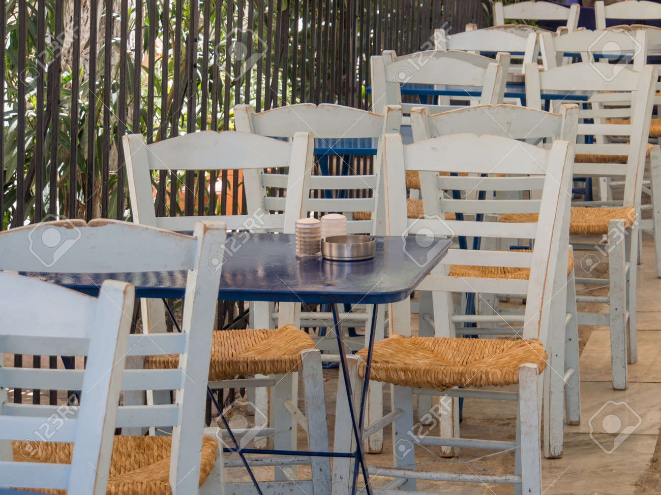Athens greece april 03 2015 empty cafe tables on a sunny morning