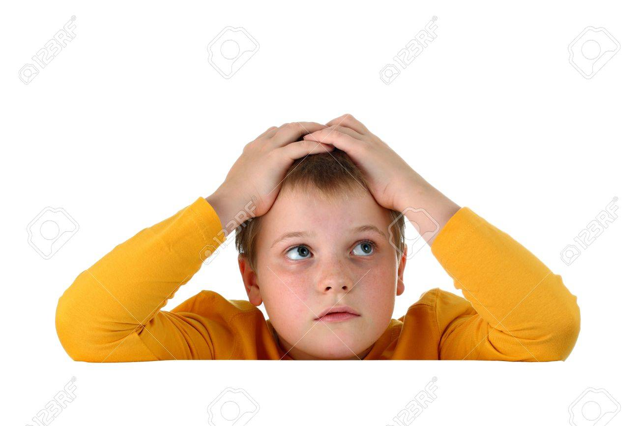 Small hopeless boy holding his head with both hands resting arms on blank whiteboard isolated on white Stock Photo - 9946879