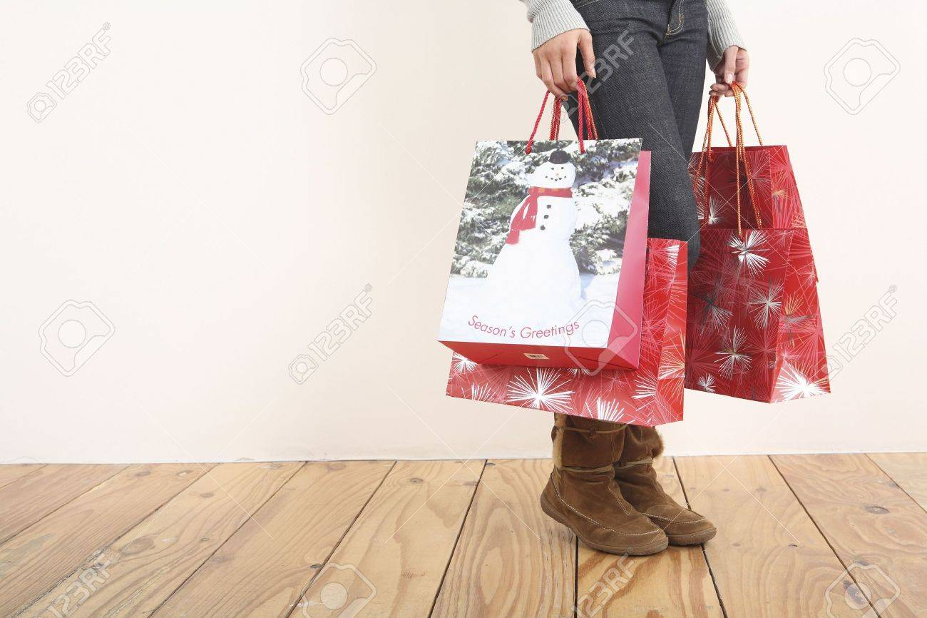 Woman Holding Christmas Shopping Bags Stock Photo, Picture And ...