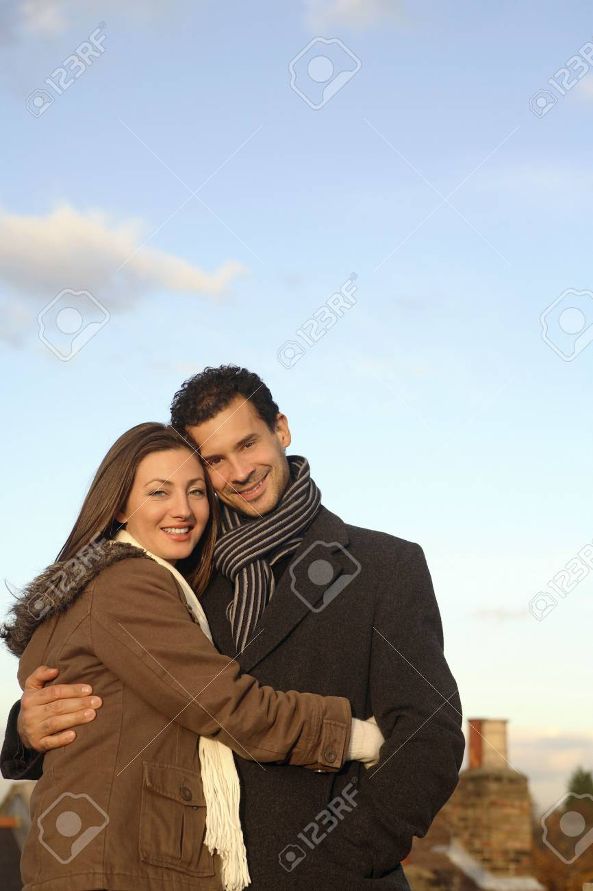 Man and woman in winter clothing hugging at the rooftop Stock Photo - 2966229