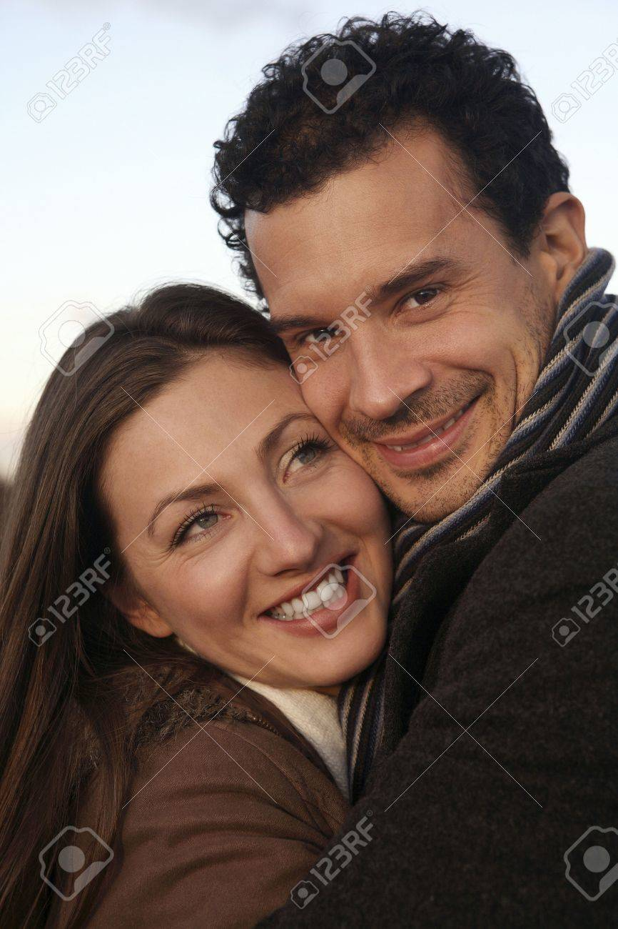 Man and woman in winter clothing hugging Stock Photo - 2966235
