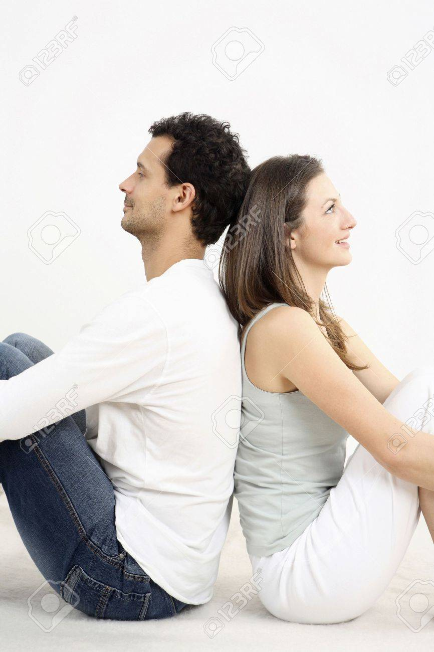 Man and woman sitting down, leaning back to back Stock Photo - 2966252