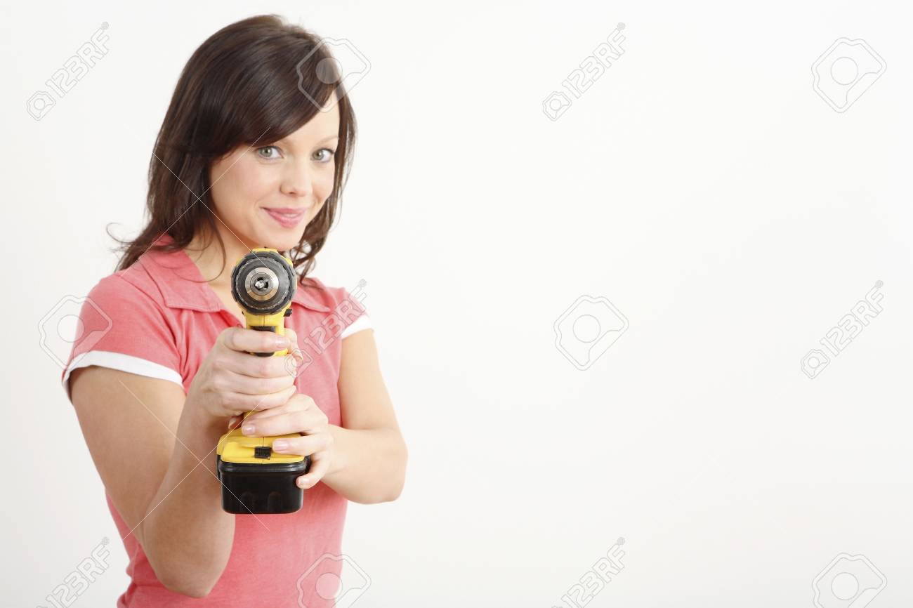 Woman posing with a power drill Stock Photo - 2966376