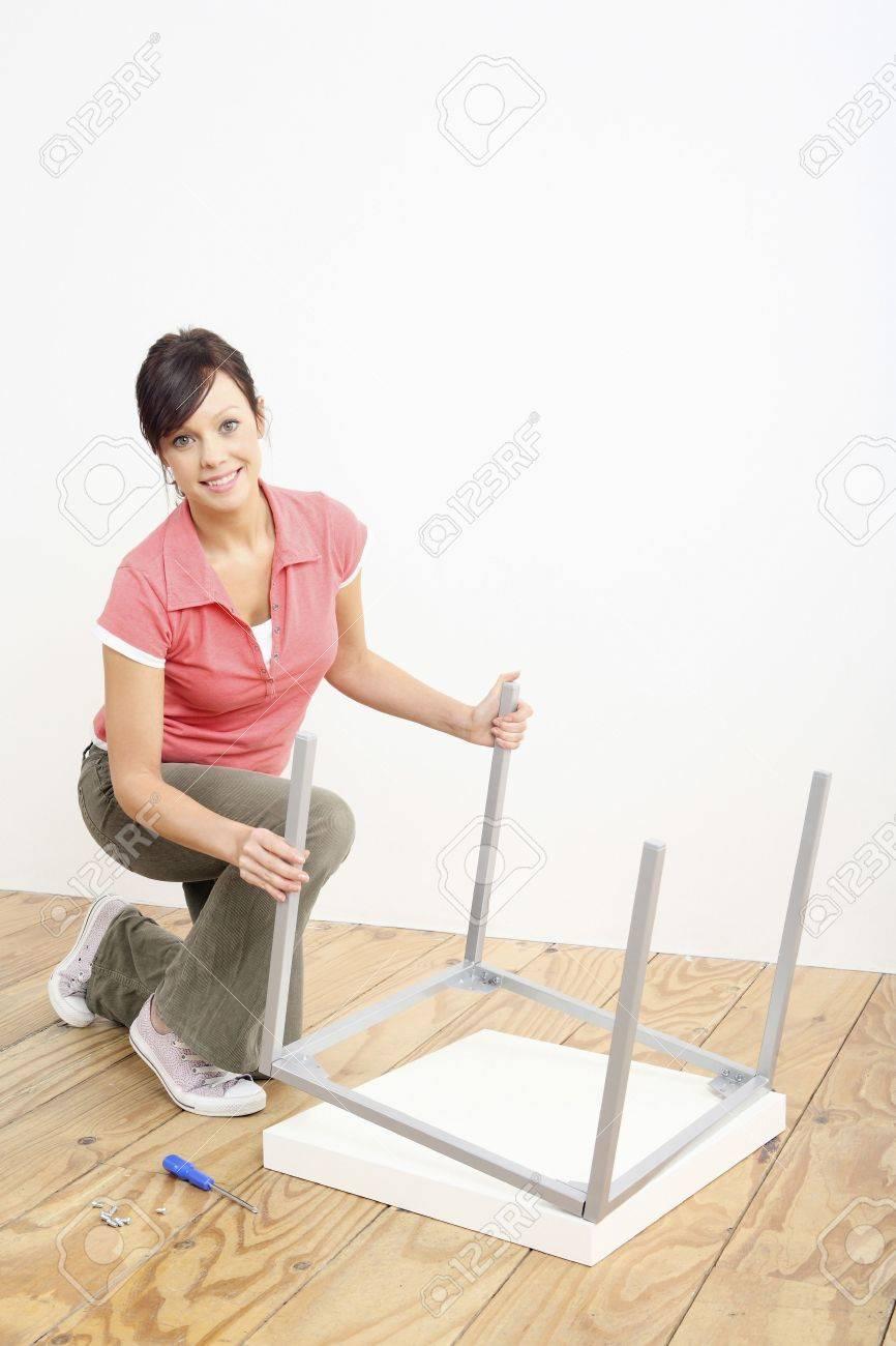 Woman assembling a table Stock Photo - 2966381