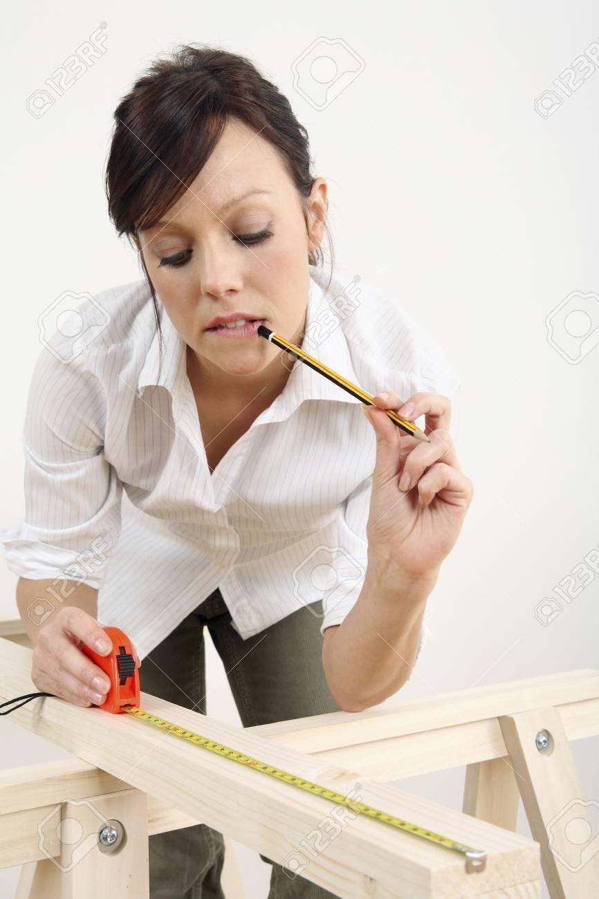 Woman measuring wood Stock Photo - 2966418
