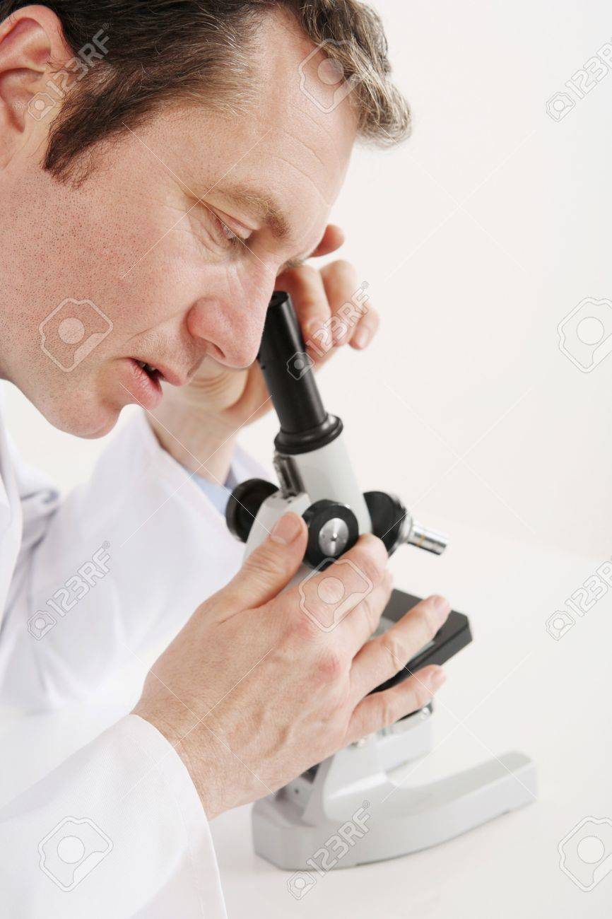 Man Using Microscope Stock Photo, Picture And Royalty Free Image ...