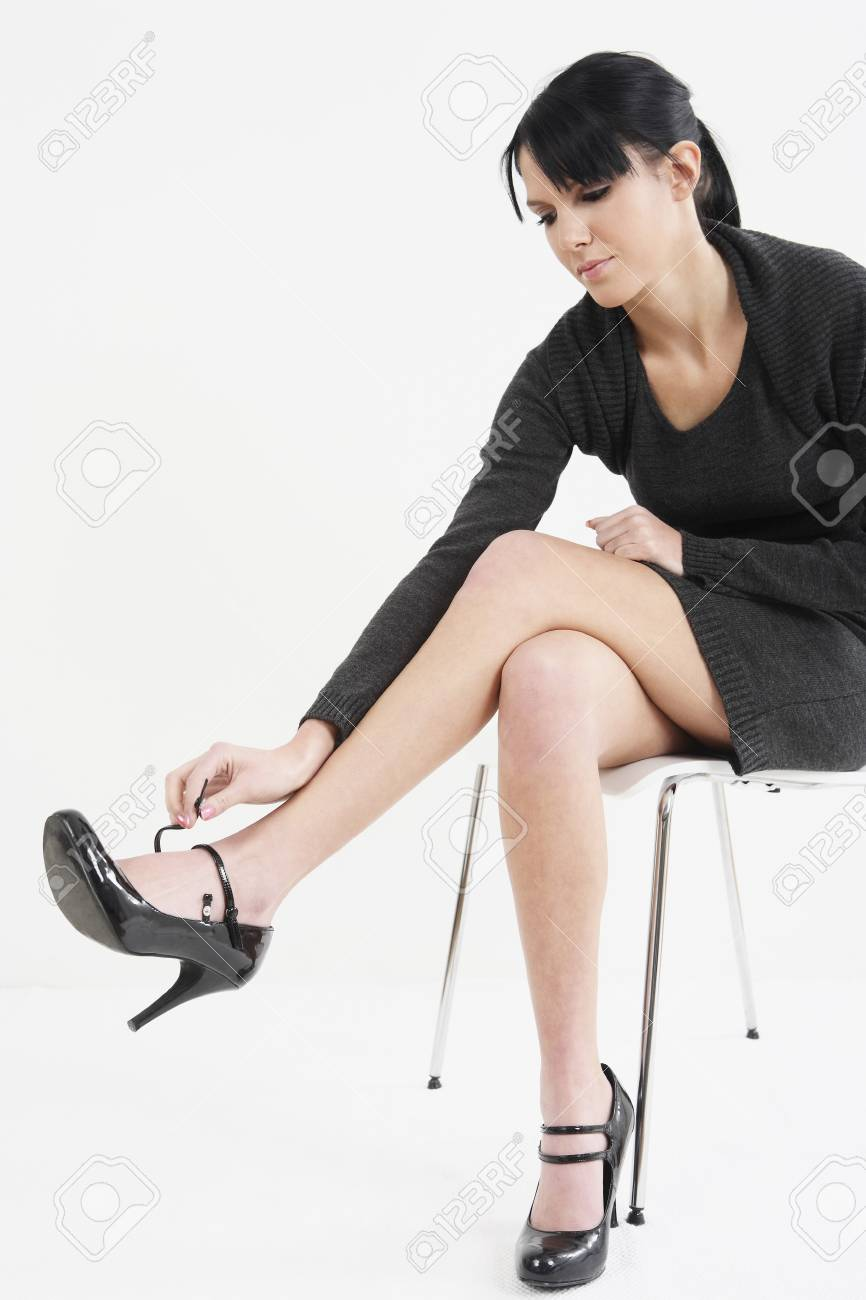 Woman adjusting strap on shoe Stock Photo - 4107304