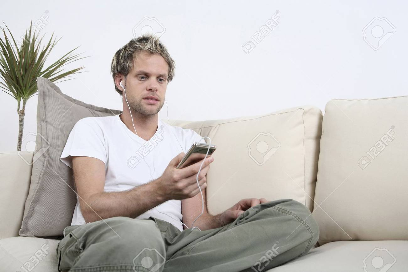 Man listening to music on his MP3 player Stock Photo - 4099821