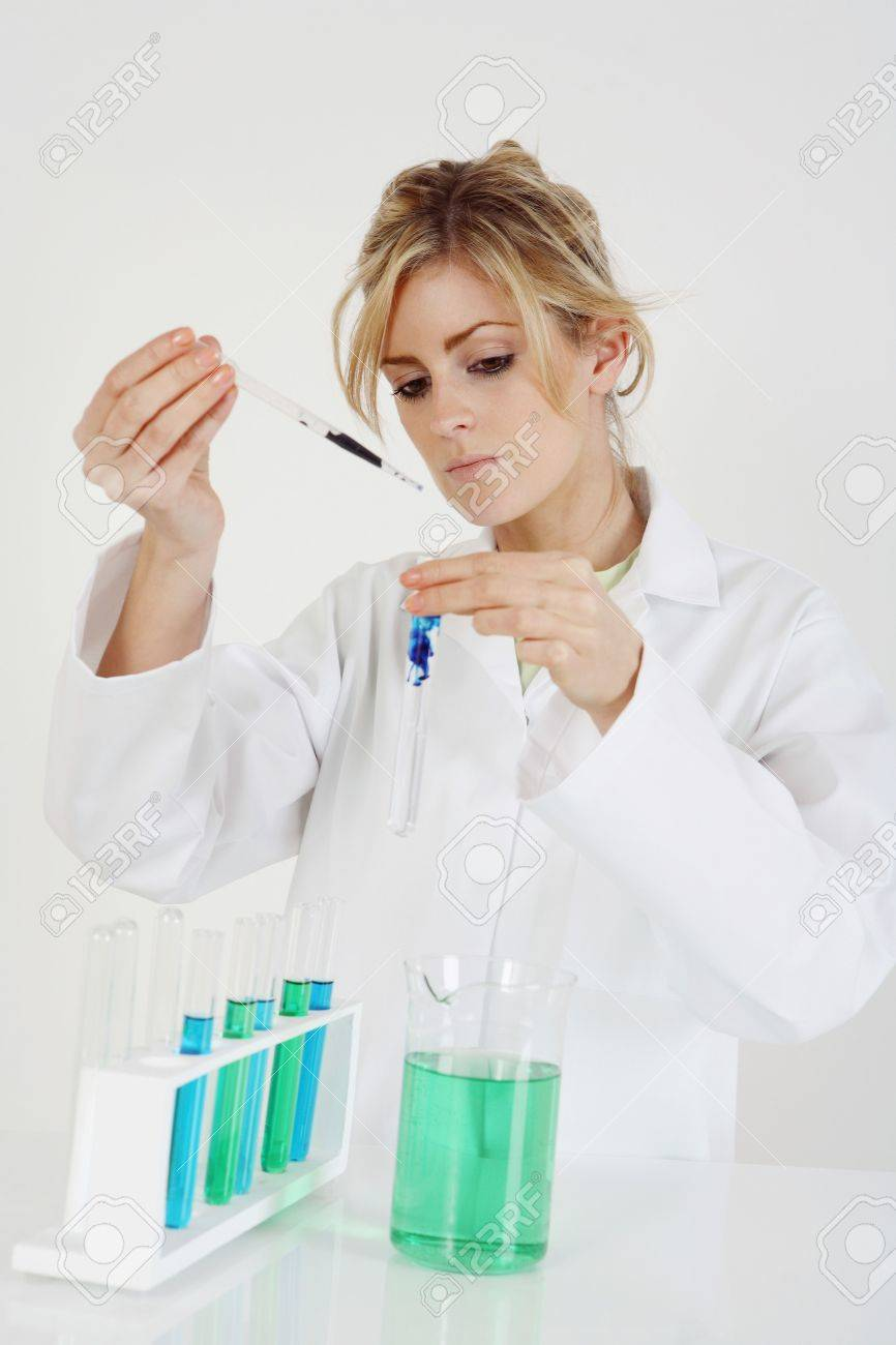 Woman In Lab Coat Carrying Out A Science Experiment Stock Photo ...
