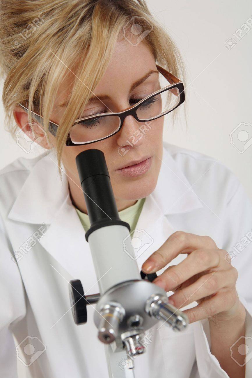 Woman Using Microscope Stock Photo, Picture And Royalty Free Image ...